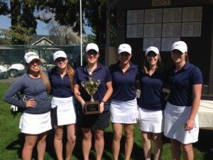 Bellevue women's golf holding the team trophy after winning the team title at the NWAC League Match at Avondale GC handily.