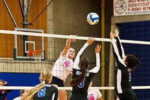 Kelcie Russell of Bellevue College hits the ball over the net