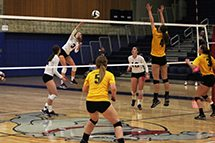 A Belllevue College volleyball player hits a shot against Shoreline