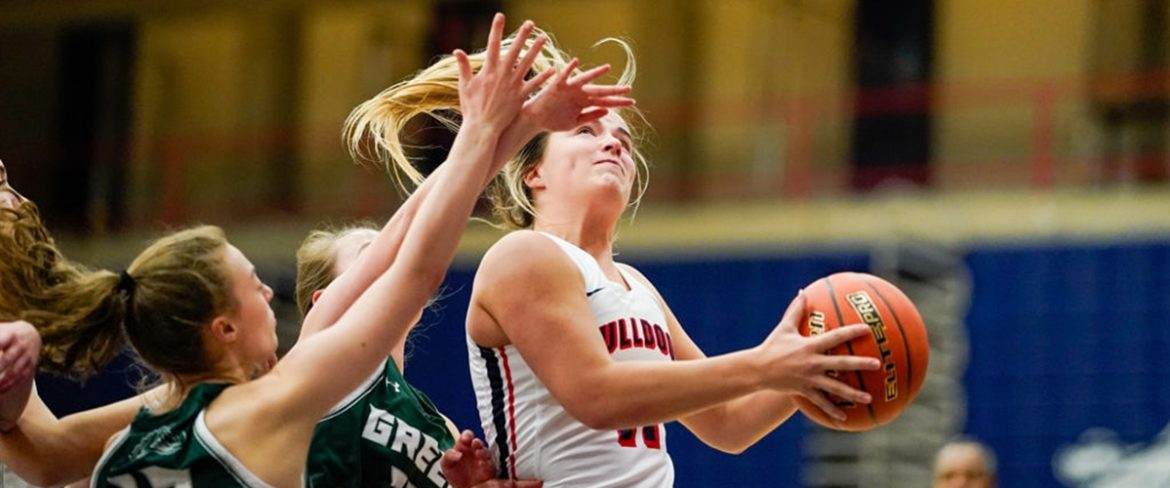 A BC women's basketball drives for a shot against a defender