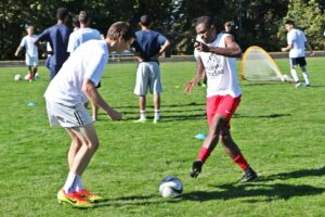 BC men's soccer players take part in ball control and passing drills at practice