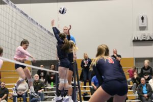 BC players attempt a block at the net