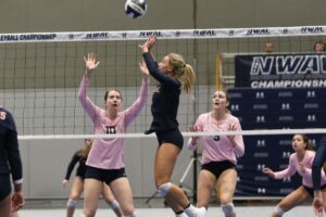 A BC player does a set pass at the net