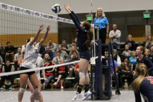 A BC player goes up for a block at the net