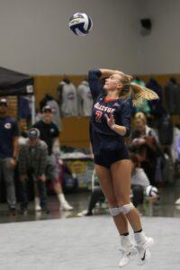 A BC player makes a jump serve