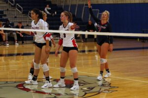 BC players get ready to receive the serve