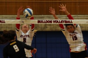 Two BC volleyball players go for the block