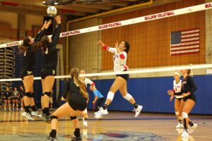 A BC volleyball player hits a shot
