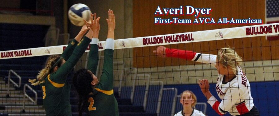 BC volleyball player Averi Dyer hits a shot at the net. First-team AVCA All-American