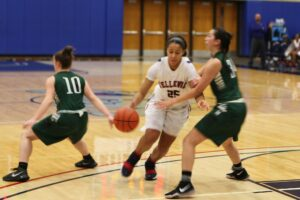 A BC player dribbles the ball against a defender