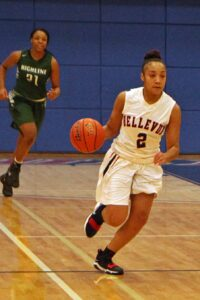 BC women's basketball player Sierra Cole dribbles the ball up the court