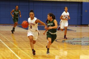 A BC player dribbles the ball up the court