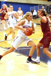 BC women's basketball plalyer Molly Dixon drives against a defender