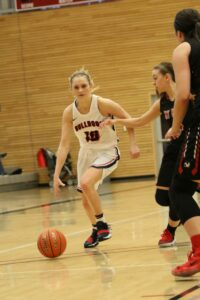 A BC player dribbles the ball past a defender