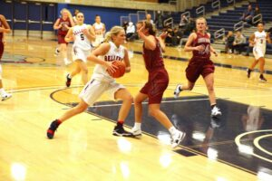 A BC player drives against an opponent