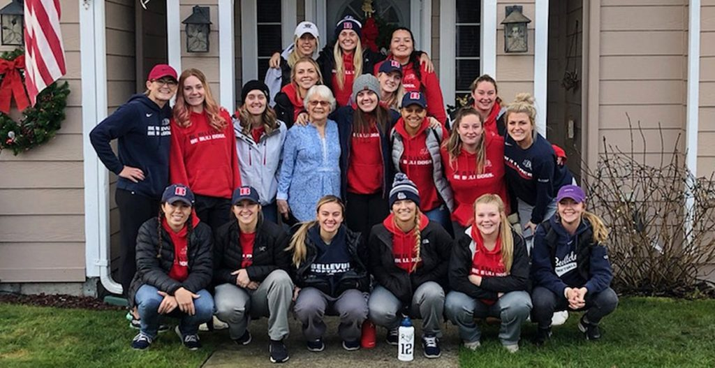 Bellevue College softball players with community members