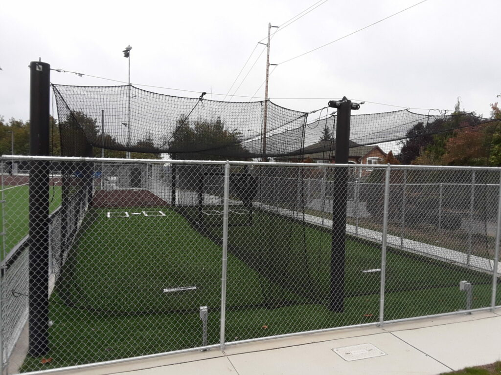 Softball field warm-up area and overhead netting