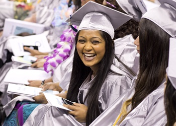 Student in cap and gown at graduation ceremony