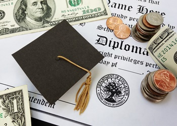 College or high school diploma with mini mortar board and money
