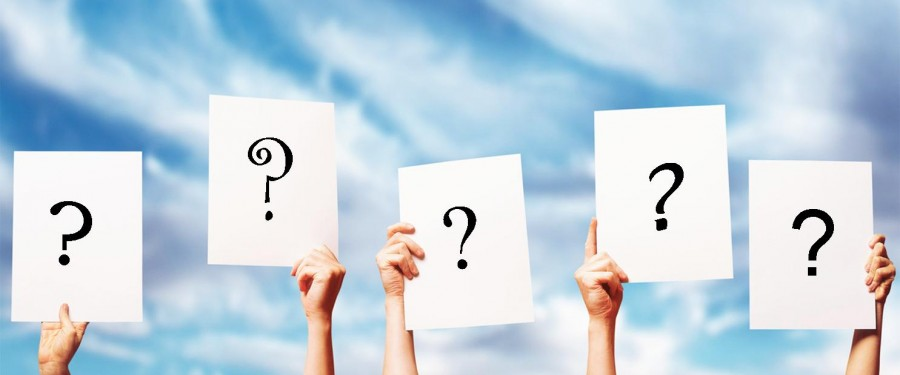 hands holding up question marks