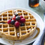 Golden Brown Waffles with fruit and syrup