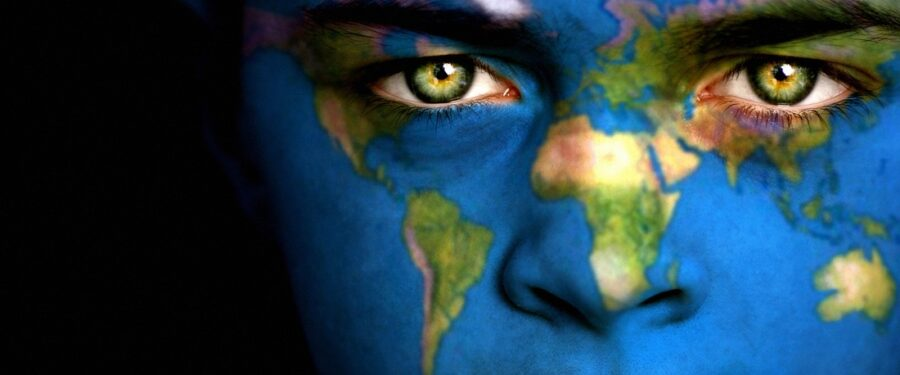 World on a human face with green eyes