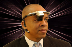 Photo of a man (Dr. Paul Jackson) wearing a headset