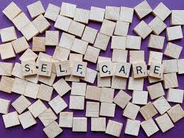 Image of Scrabble tiles spelling out Self Care