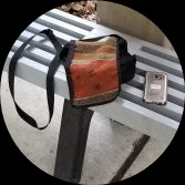 Purse and Cellphone on a Grey Bench