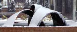 snow on the c building water fountain