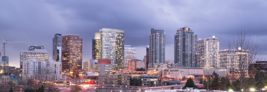 A clear panoramic view of Bellevue, WA with a storm passing at dusk