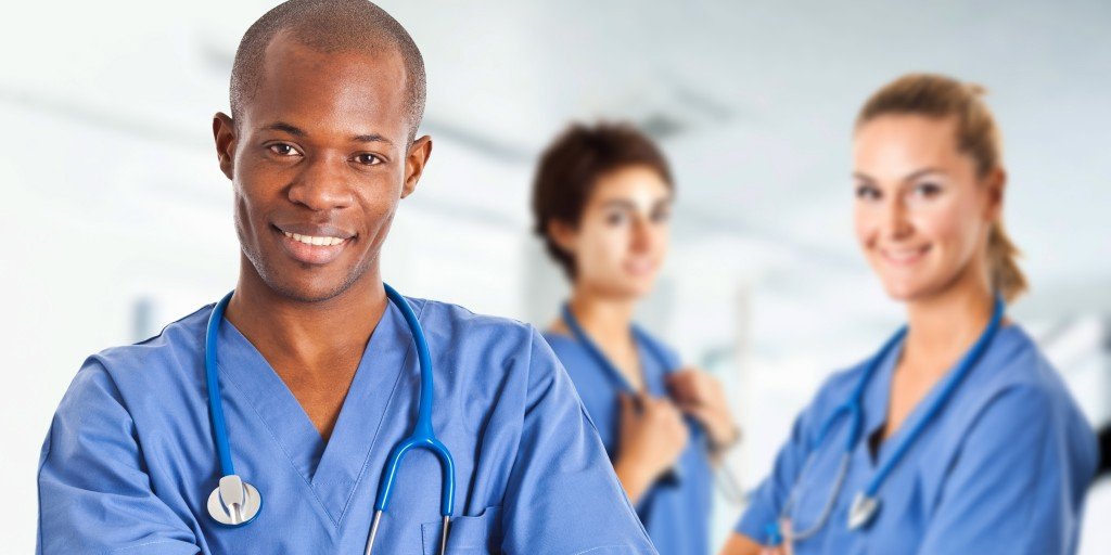 people wearing scrubs and smiling