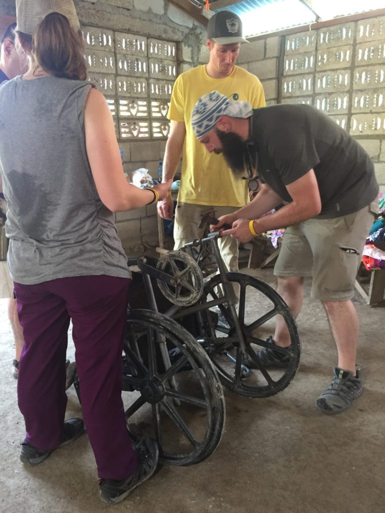 students repairing a wheelchair