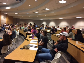 Photo of students in a lecture hall watching an MBS seminar.