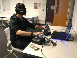 Student and a flight simulator