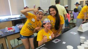 Anatomy and Physiology students help facilitate activities about the brain.