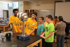 BC physics students showing Tesla coils to middle school visitors