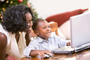 child and parent using computer