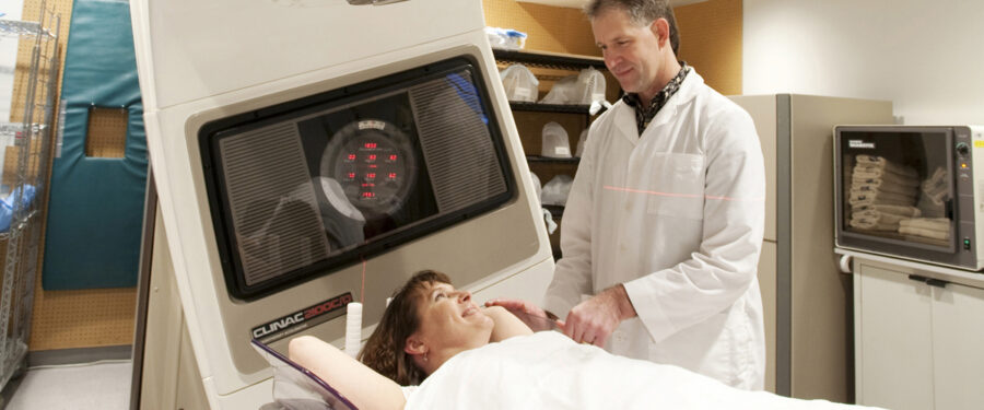 Picture of patient receiving radiation treatments from a radiation therapist.