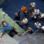 Picture of students rock climbing.