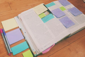 post it notes (with notes on them) inside a textbook