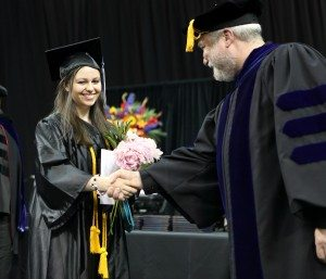 BC President Dave Rule congratulates April Berning during BC's commencement ceremony