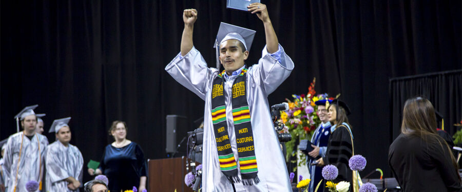 A 2015 BC grad celebrates at the commencement ceremony