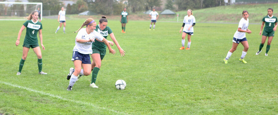 A Bellevue College player advances the ball against Green River in a women's soccer match