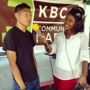 Sonya Green interviews a member of the community at the Crossroads Farmer's market.