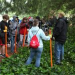 BC's crew of volunteers gets instruction on invasive plant removal at Robinswood Park from Paul Anderson of the City of Bellevue's Forest Management Program during BC Cares Day.