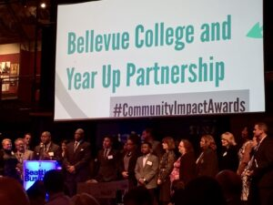 A photo of Bellevue College and Year Up receiving the Community Impact Award.