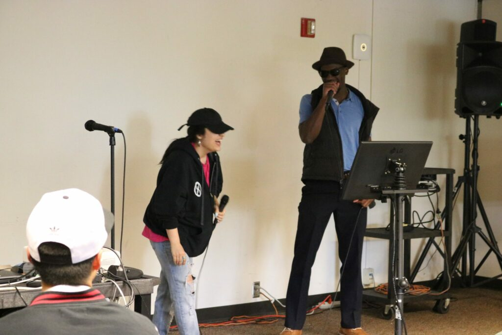 Students participate in karaoke events.