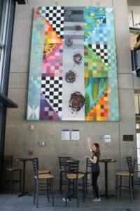 Artist Renaise Kim displays her painting.