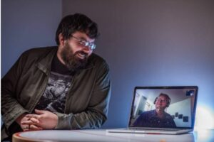 James Riggall meeting remotely with Bruce Wolcott